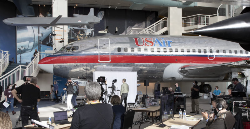 Film crew at the Museum of Flight in production in front of a legacy US Air 737.
