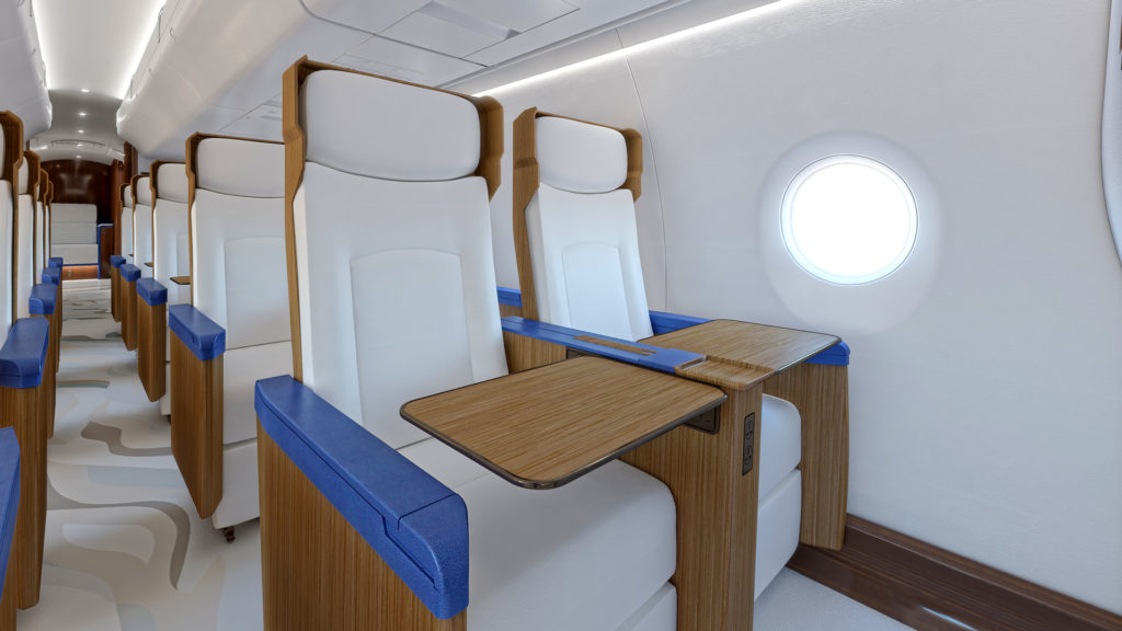 Interior cabin of Exosonic, Inc aircraft showing rows of seats in white fabric, with blue trim and wooden tray tables