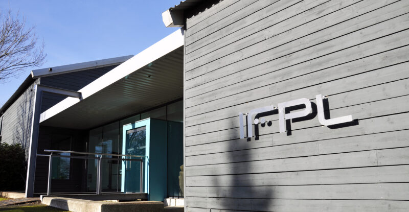 IFPL headquarters. A grey building with IFPL on the side of it.