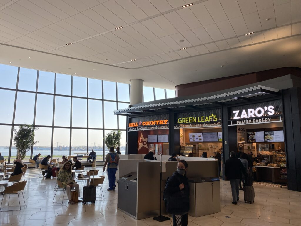 LaGuardia's food court showing the different options and large floor to ceiling windows.