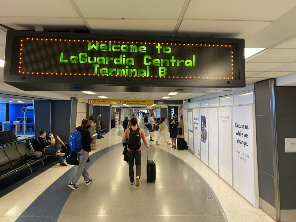 Welcome to LaGuardia Central Terminal B is on a digital sign as you enter the airport.