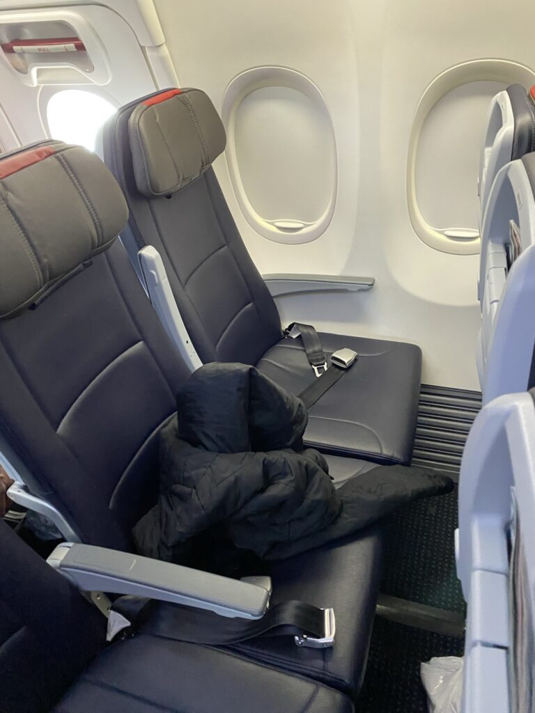 Economy class seat on American Airlines' Boeing 737-800. In greys and blacks.