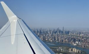 View of aircraft wing looking out over New York City leaving LaGuardia.