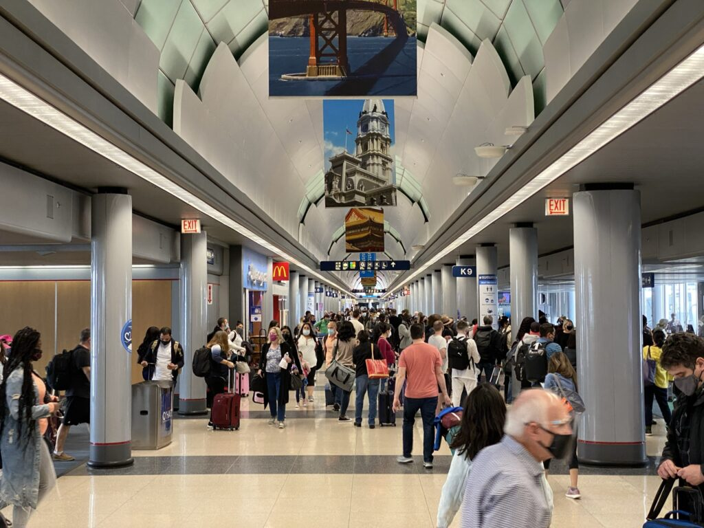Chicago O'Hare Airport Terminal buzzing with people.