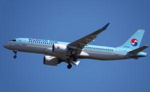 Korean Air A220 Aircraft in flight with a clear blue sky.