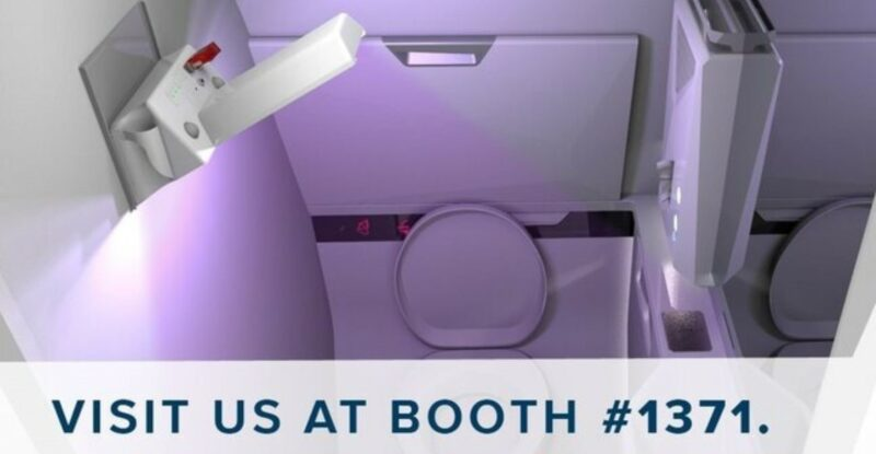 """Diehl Aviation's Portable Clean Light casting a purple light over a aircraft lavatory. The words """"visit us at booth #1371"""" are at the bottom of the image."""