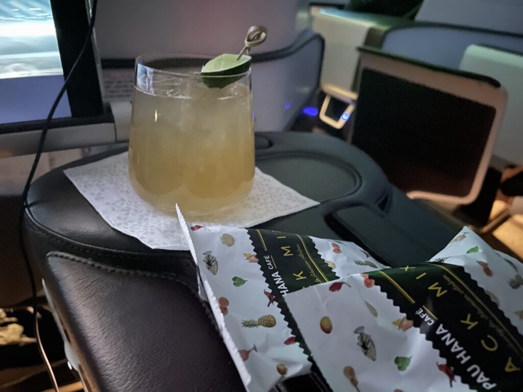 Hawaiian Airlines' Mule with packaged snacks on a aircraft tray table.