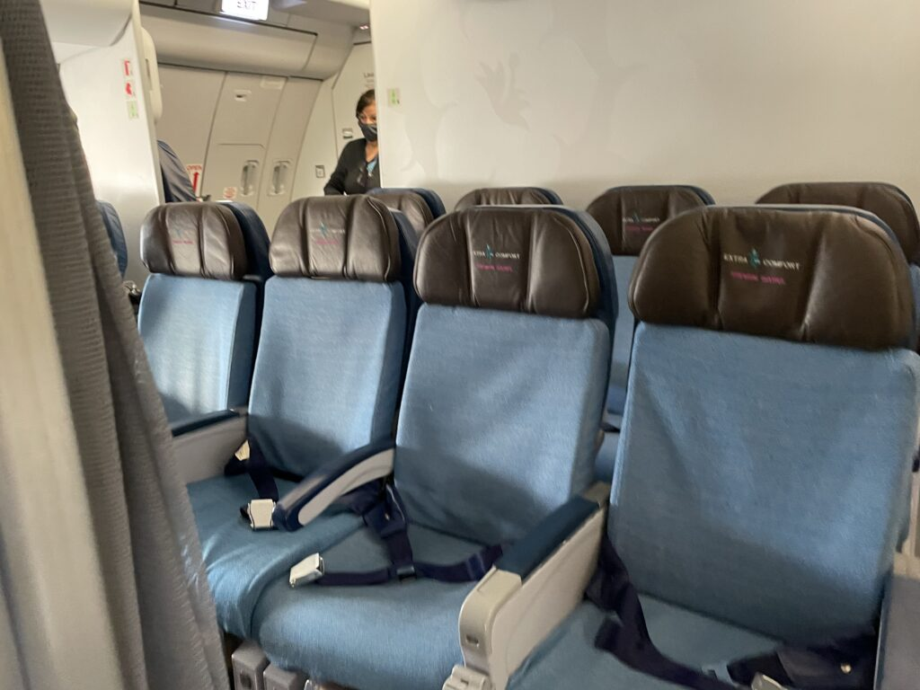 Extra comfort seats on Hawaiian Airlines. Blue with deep brown headrests.