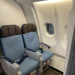 Extra Comfort seats on Hawaiian Airlines in blue with brown headrests.