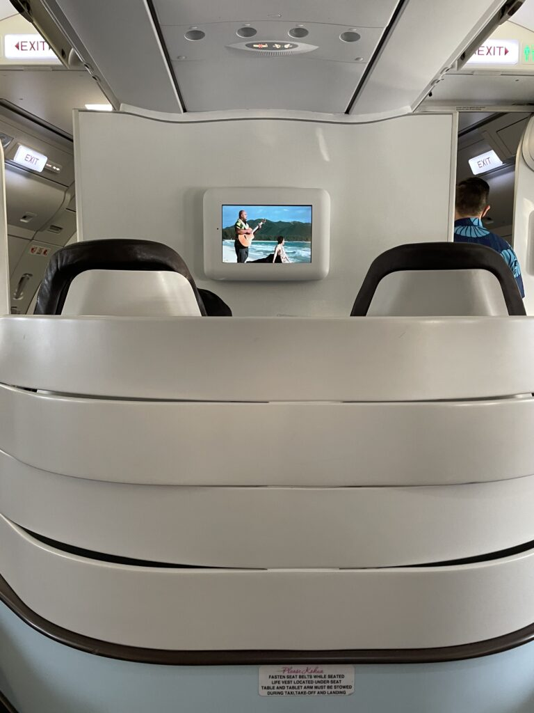 The hard thermoplastic shell around two first class seats, with a small screen on the monument in front of them