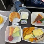 Hawaiian Airlines' breakfast spread in first class. Eggs, fruit, and bread.