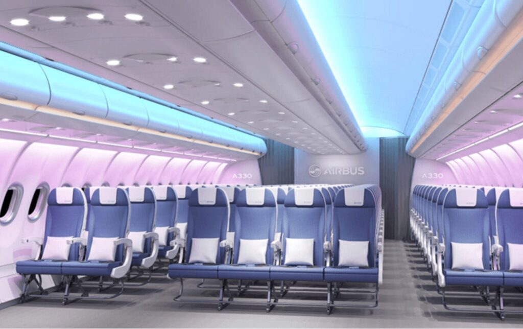 Bright pink and blue hues are seen in this Airbus widebody with Spectrum mood lighting