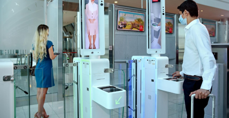 Vision-box biometric contactless gate for Emirate. A man and a women attempt entry.