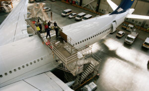 Top view of workers on the exterior of a Lufthansa aircraft.