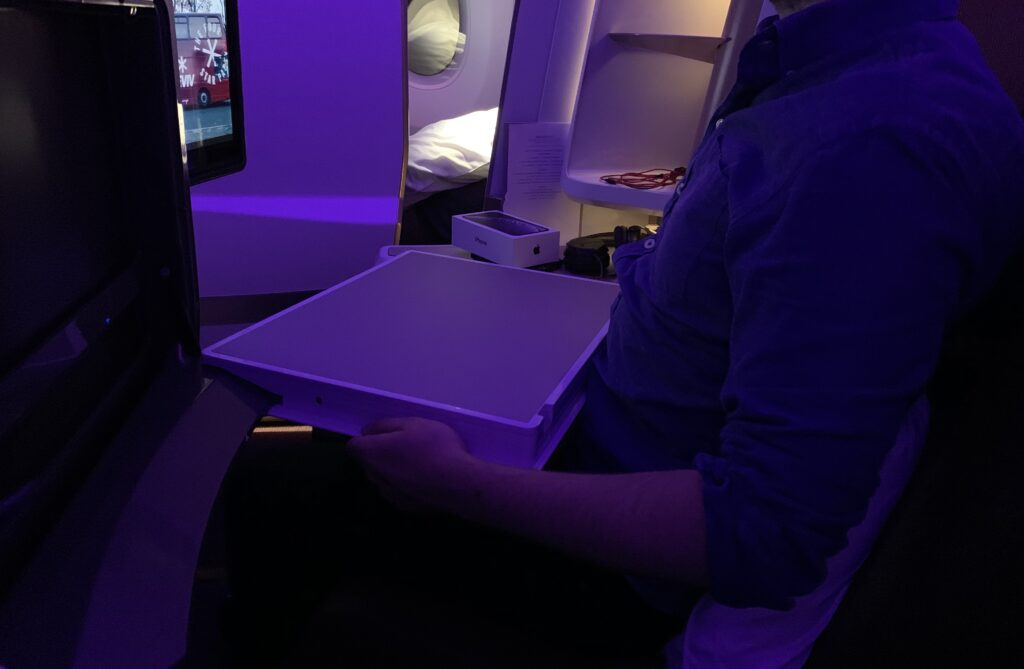 Cirrus NG on Virgin with a passenger demonstrating how the table created very little space to move.