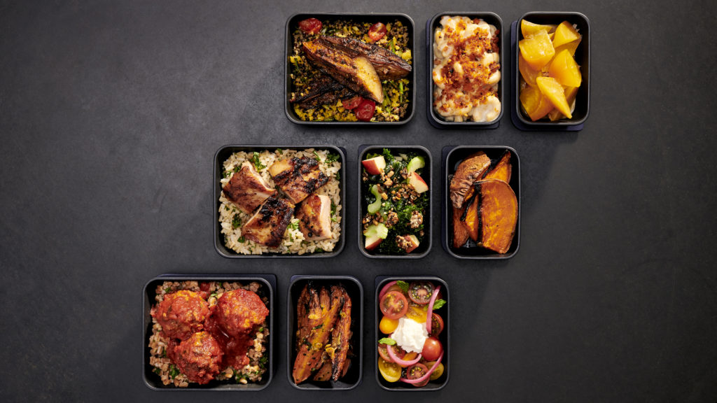 Nine dinner dishes in sets of 3 on a charcoal backdrop. These dishes (one main and two sides each) will be part of the new Core Economy inflight meal experience