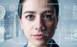 authentication-by-facial recognition concept a women behind what looks like a recognition screen.