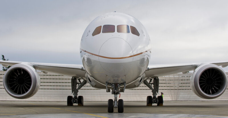United Airlines Boeing 787 Dreamliner front view of the nose on the runway. Clouds in the sky.