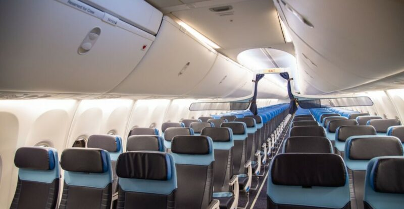 Boeing 737 KLM cabin with deep brown fabrics and light blue