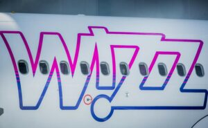 Zoomed in shoot of the WIZZ logo on the side of an aircraft.