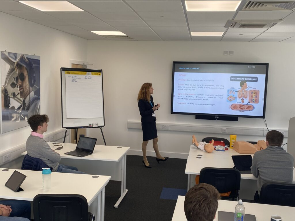 Skyborne's cabin crew attestation course includes a mix of practical and classroom teaching. Here, Hajati Treacher-Morley leads a class..