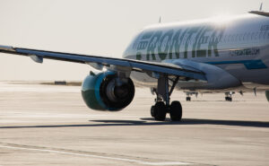 Frontier Airlines aircraft on the runway.