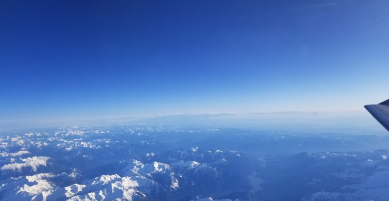 looking above mountains with a clear blue sky.