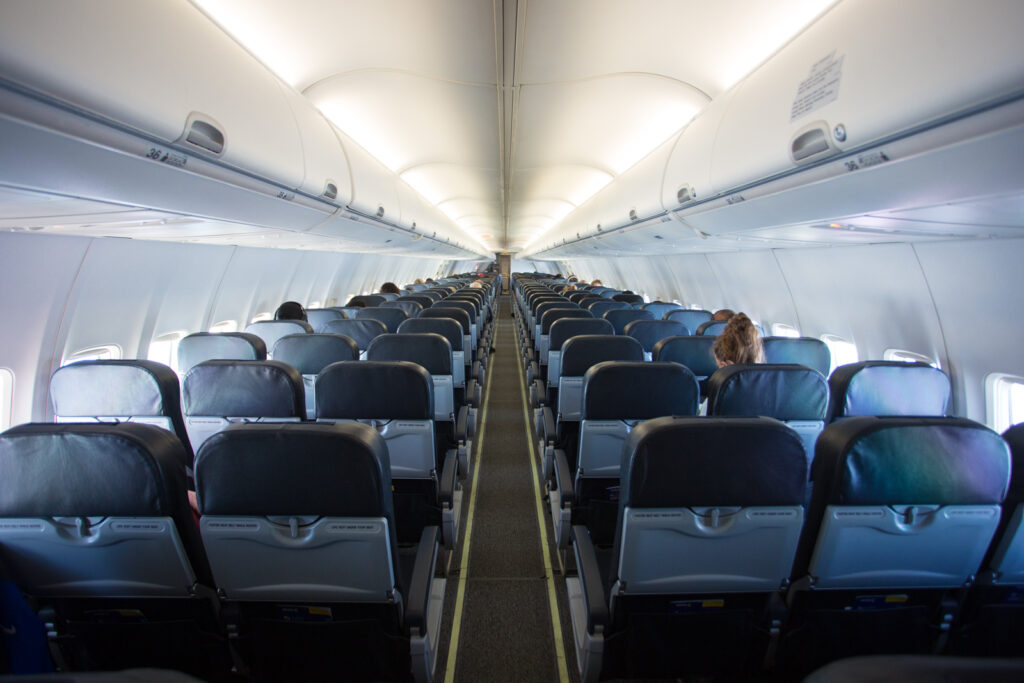 Avelo Boeing 737-800 interior in a 3-3 layout with blueish-grey seating.