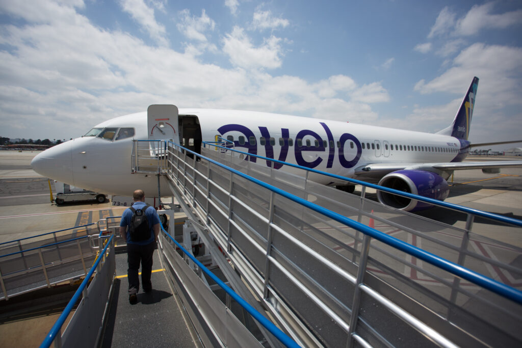 Roll-up ramps set up as passengers walk them to enter the Avelo Aircraft for their flight.