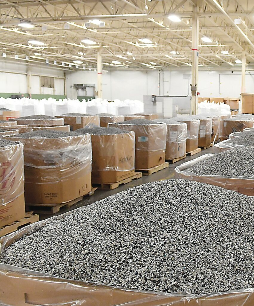 A warehouse full of large boxes that contain shredded plastic.