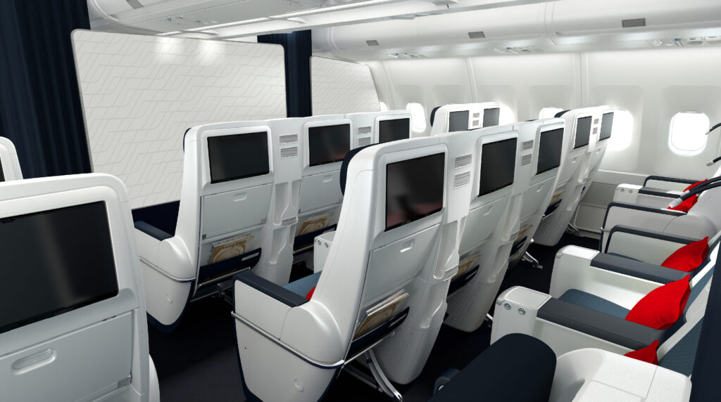 Two rows of premium economy aircraft seats. White with grey details and red pillows.