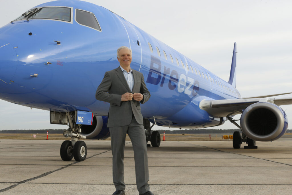 Founder and CEO David Neeleman stands in front of a Breeze E-Jet