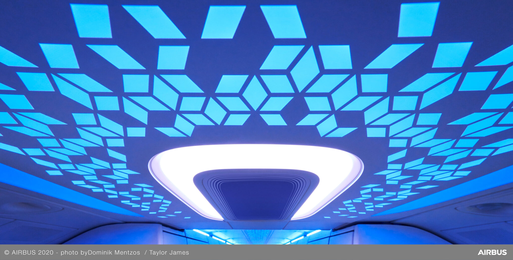 Close up of Diehl's ceiling panel showing geometric shapes pattern in shades of blues and purples.