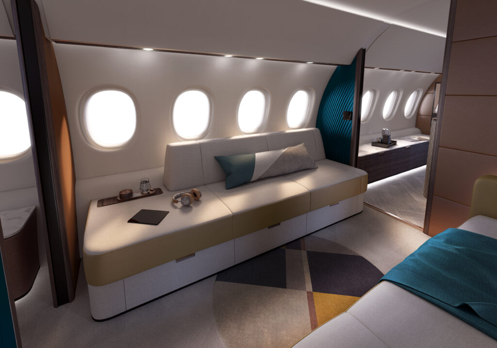 Falcon 10X interior showing a long, comfortable bench, and four windows.