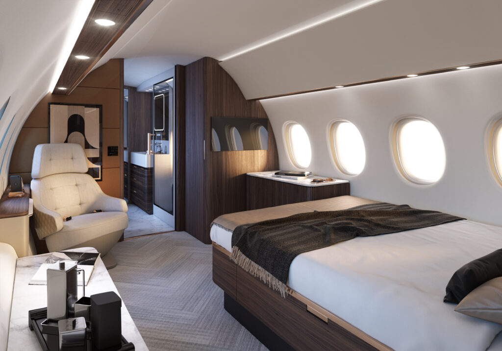 Falcon 10X interior, with a queen bed, a lounge chair and a side table in browns and creams