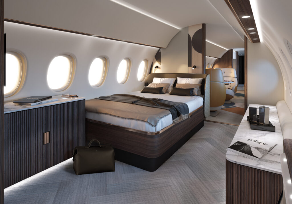 Falcon 10X with a queen bed suite. White and brown pillows, blankets and decor.