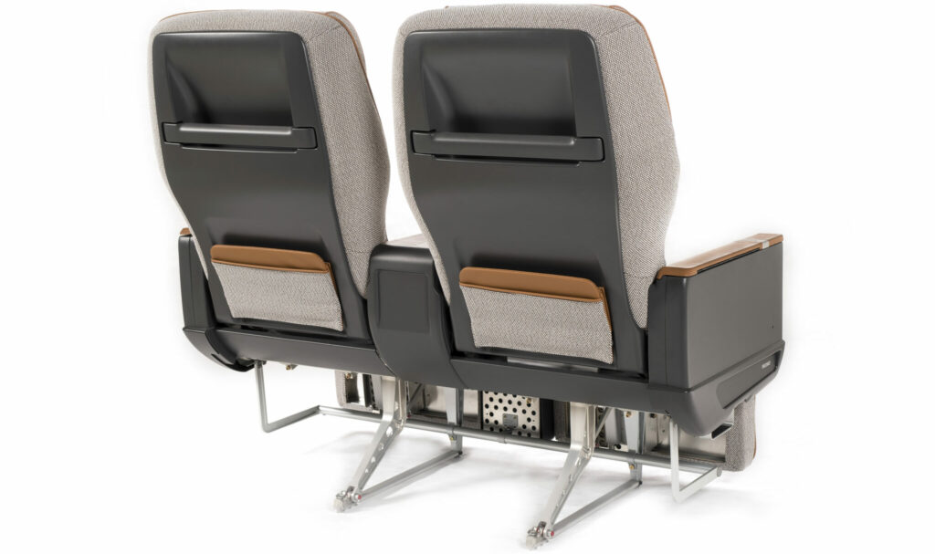 Two premium aircraft seats on a white background. Seats are different shades of grey and shown from the back.