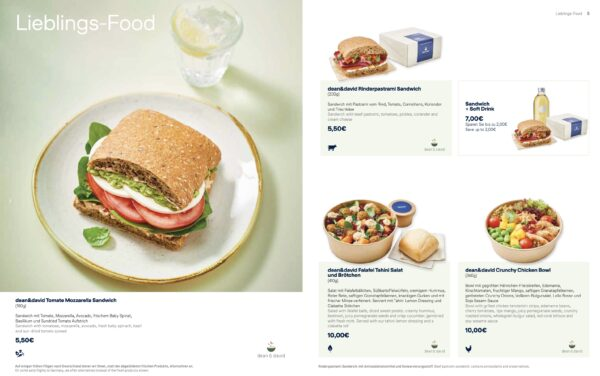 The half sandwich, revealed, on a menu card showing 3 different meal options with details and prices.