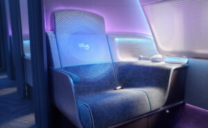 PureSkies by PriestmanGoode. Purple and blue lighting casting down on a business class seat. Hygienically safe air travel.