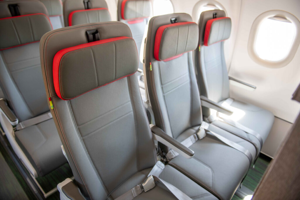 Tap Airlines Airbus hybrid configuration with Recaro. Aircraft seats are grey with red trim on the headrest.