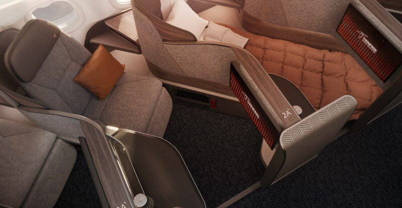 Thompson Solo business class herringbone seat in grey and brown tones. View is from the top.