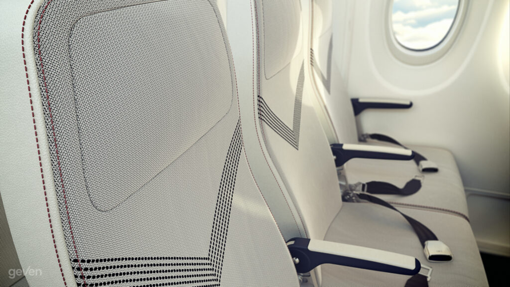 Close up of the Geven SuperEco seat. The seat is white with a grey V pattern design in the center.