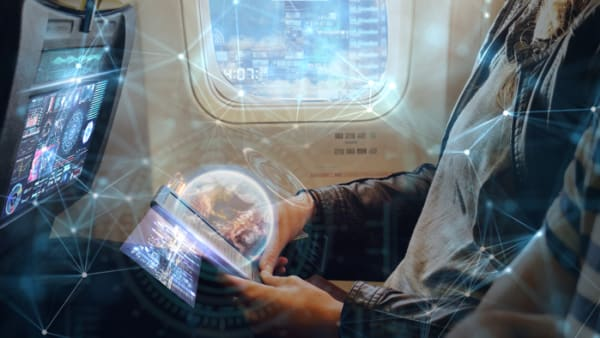 Conceptual connectivity image with a person on their mobile device behind it.