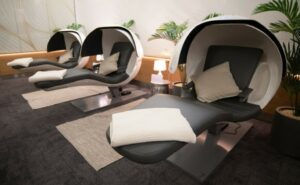 power nap pods in grey with white pillow and blanket.