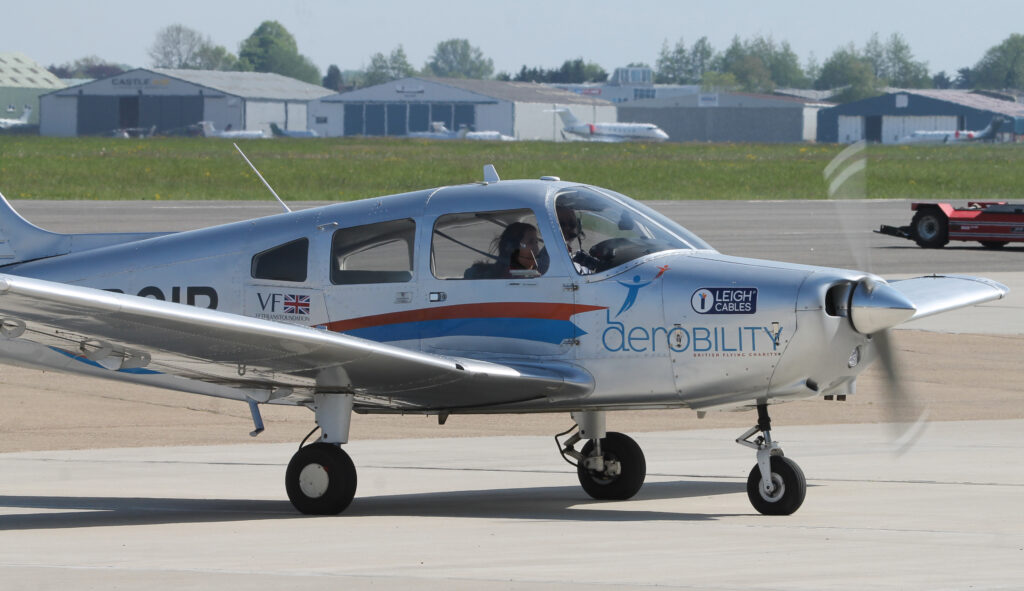 One of Aerobility's Warriors taxies back at the end of Sophie's return to flight. The aircraft features Aerobility's logo.