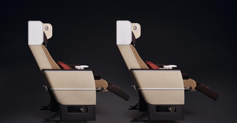 SWISS Premium Economy Class seat side view on a black background.