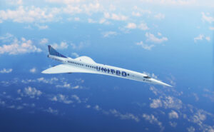 The Overture supersonic aircraft in United Airlines' livery, flying high above the clouds