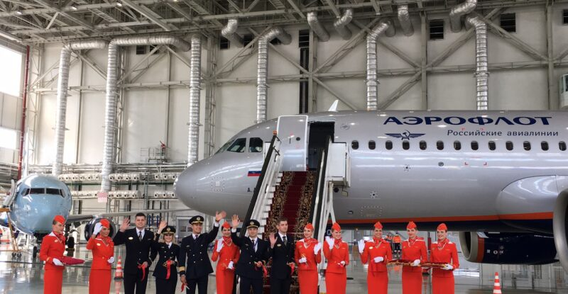 Aeroflot Airbus a320neo in a hanger with cabin crew standing out front.