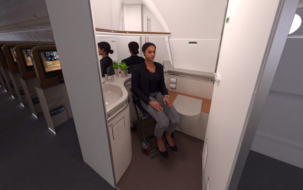 A woman sitting in a wheelchair in the lavatory on an aircraft.