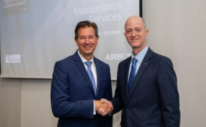Two men shaking hands for the Airbus Delta digital alliance deal.